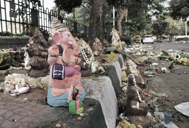 Idols and waste being dumped on the pavement. By The Hindu