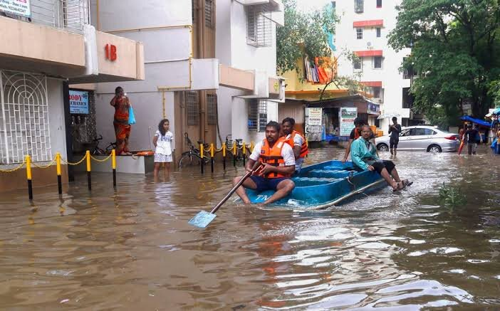 Residents of a housing society choosing to row themselves along the flooded roads
