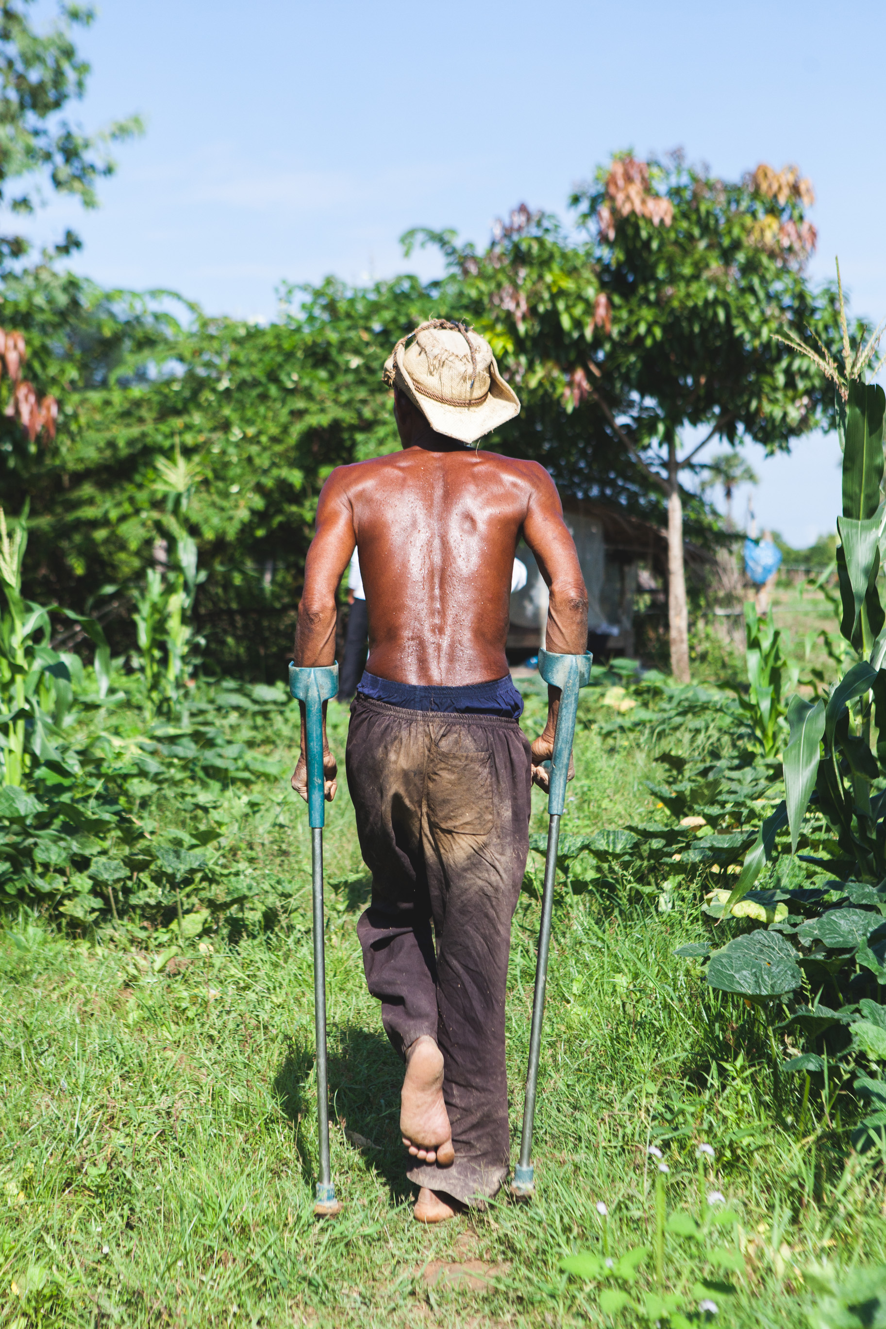 Though this grandpa broke his leg more than a decade ago from falling out of a palm tree, today he is his community's model farmer in rural Kampong Speu province, Cambodia
