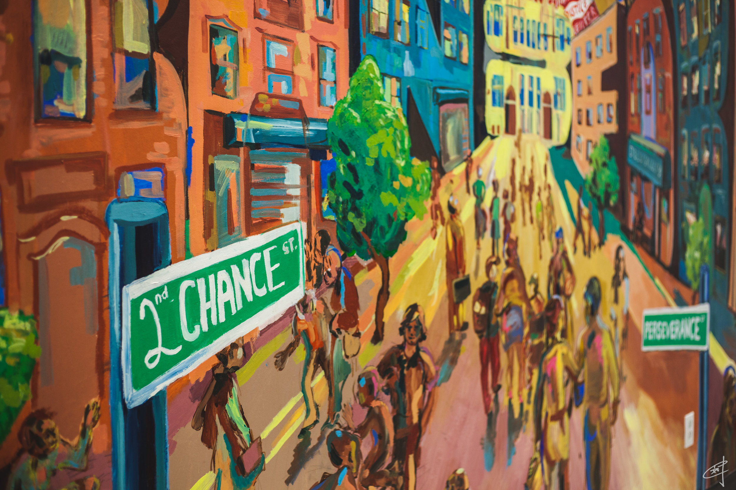 A mural at the Red Hook Community Justice Center advocates second chances and perseverance.