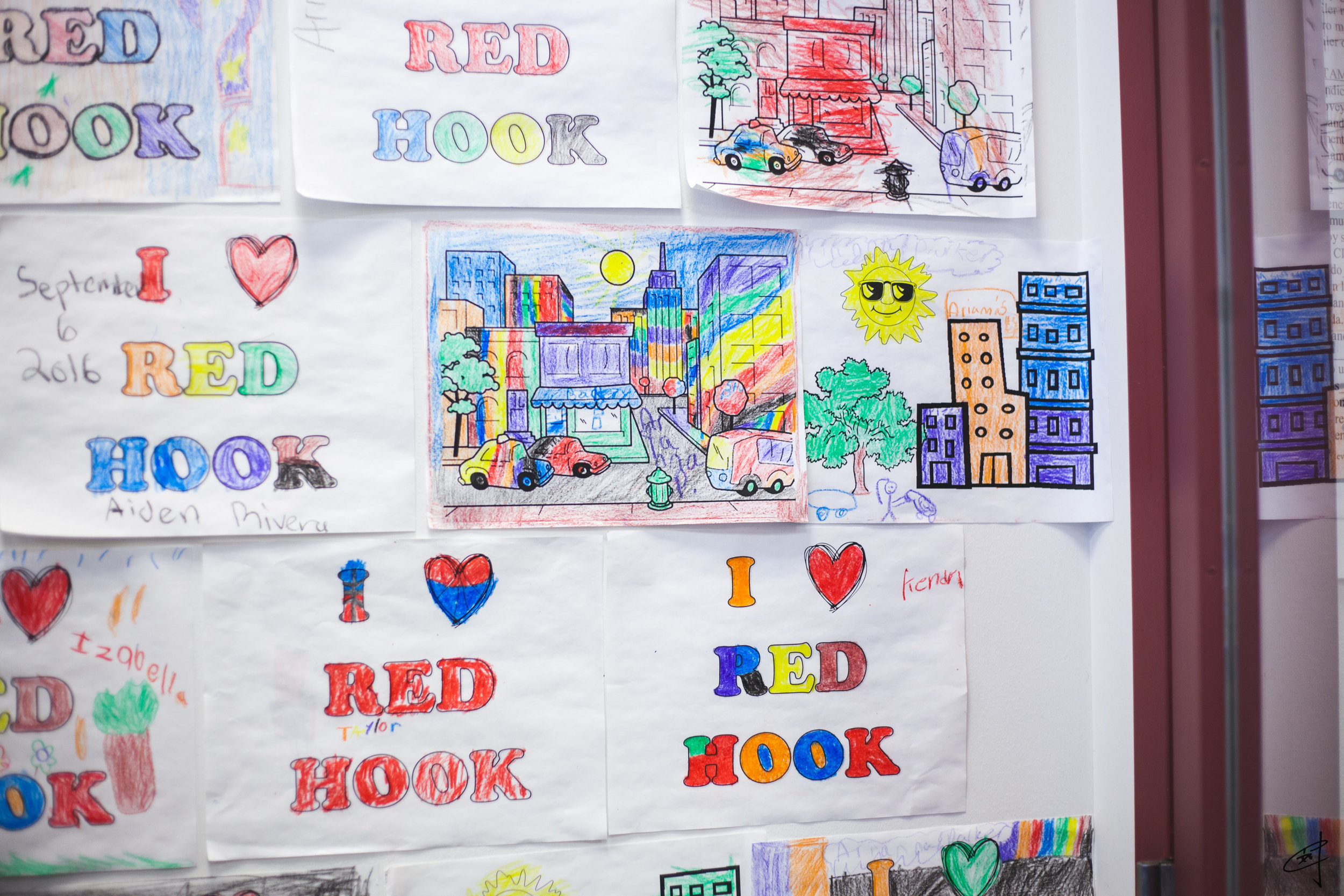 """I Love Red Hook"" colorings cover an entire wall at the court's Housing Resource Center."