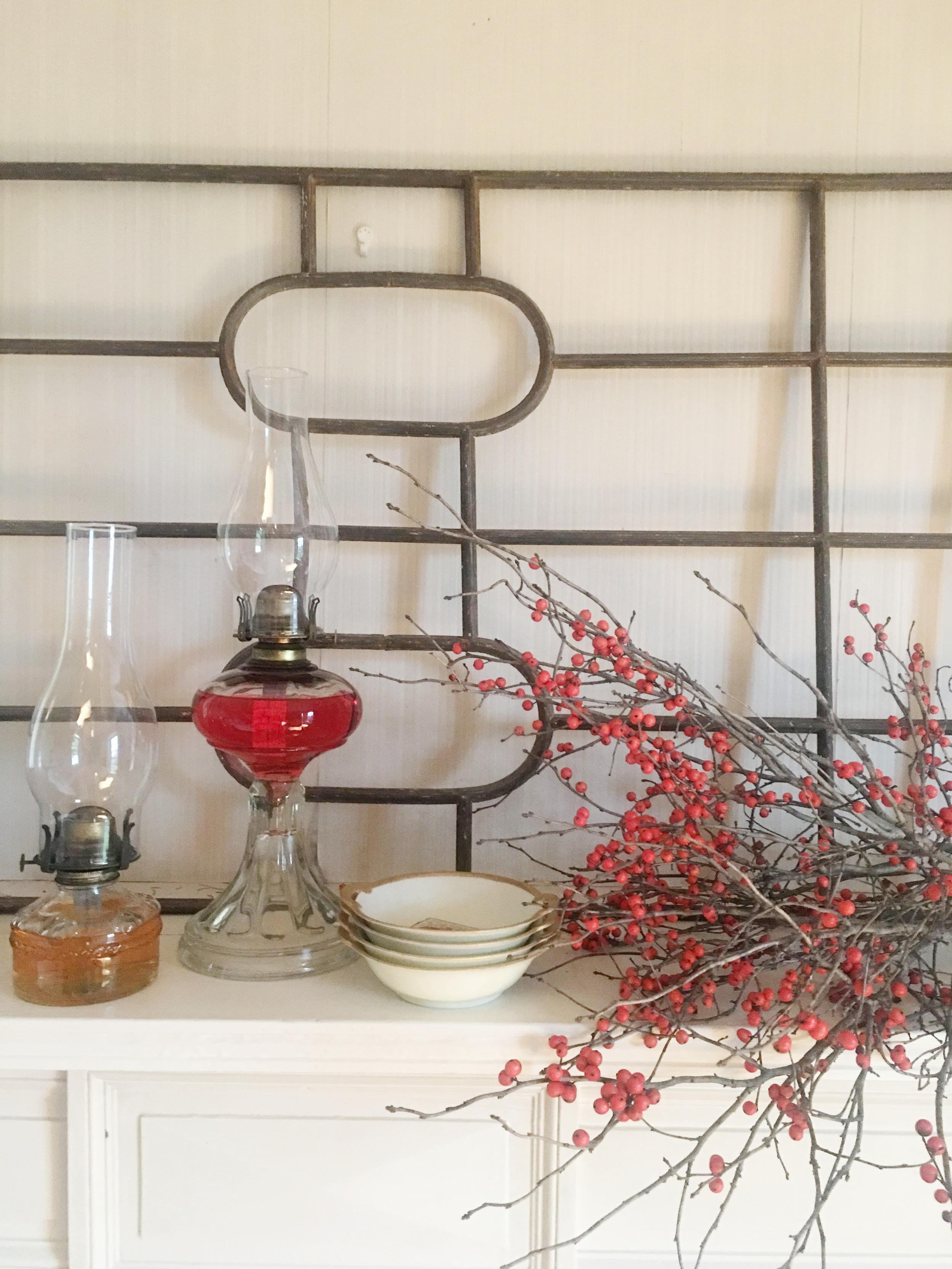 A Christmas vignette created with our oil lamps, my Great Grandmother's handpainted bowls and Ilex berries from my Mom's home in Northern Ontario.