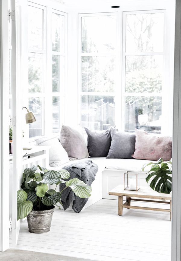 Photo Source: Pinterest via Bloglovin'  I love the brass elements and the muted jewel tones of these pillows. The white painted floors really make this space, but hopefully we'll get the same feeling with the white beadboard on the ceilings and walls. Now, if only I could keep some indoor plants alive at the farm!
