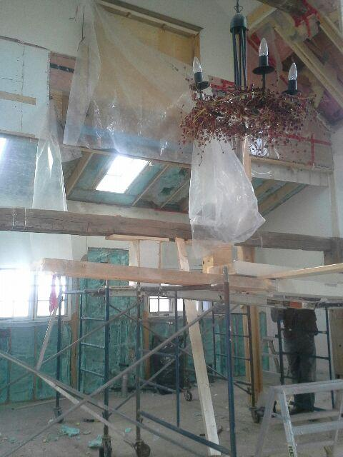 You can see the stained glass window has now been removed.  Note:We will eventually remove the Christmas berries from the hanging light fixtures!!
