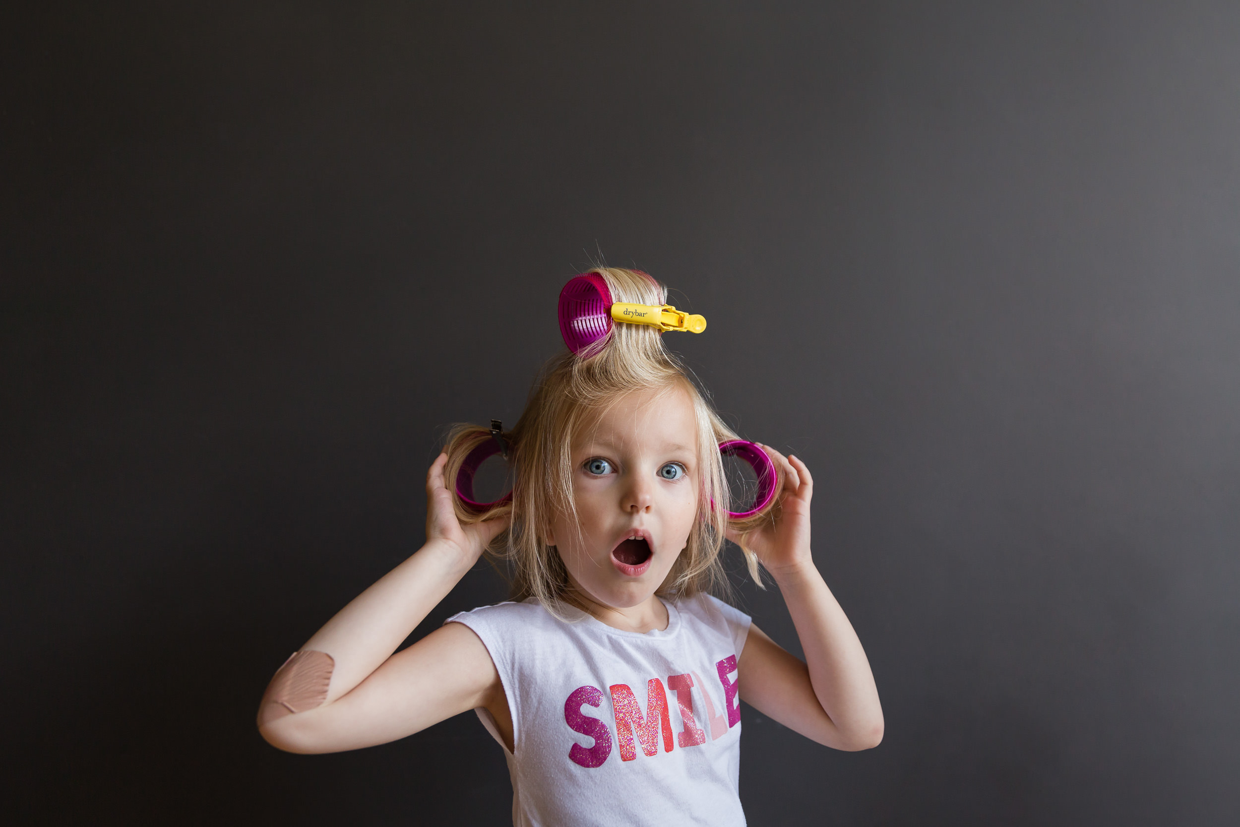 girl_in_smile_shirt_with_pink_rollers_in_blond_hair_in_Personal_portfolio_by_rebecca_hunnicutt_farren.jpg