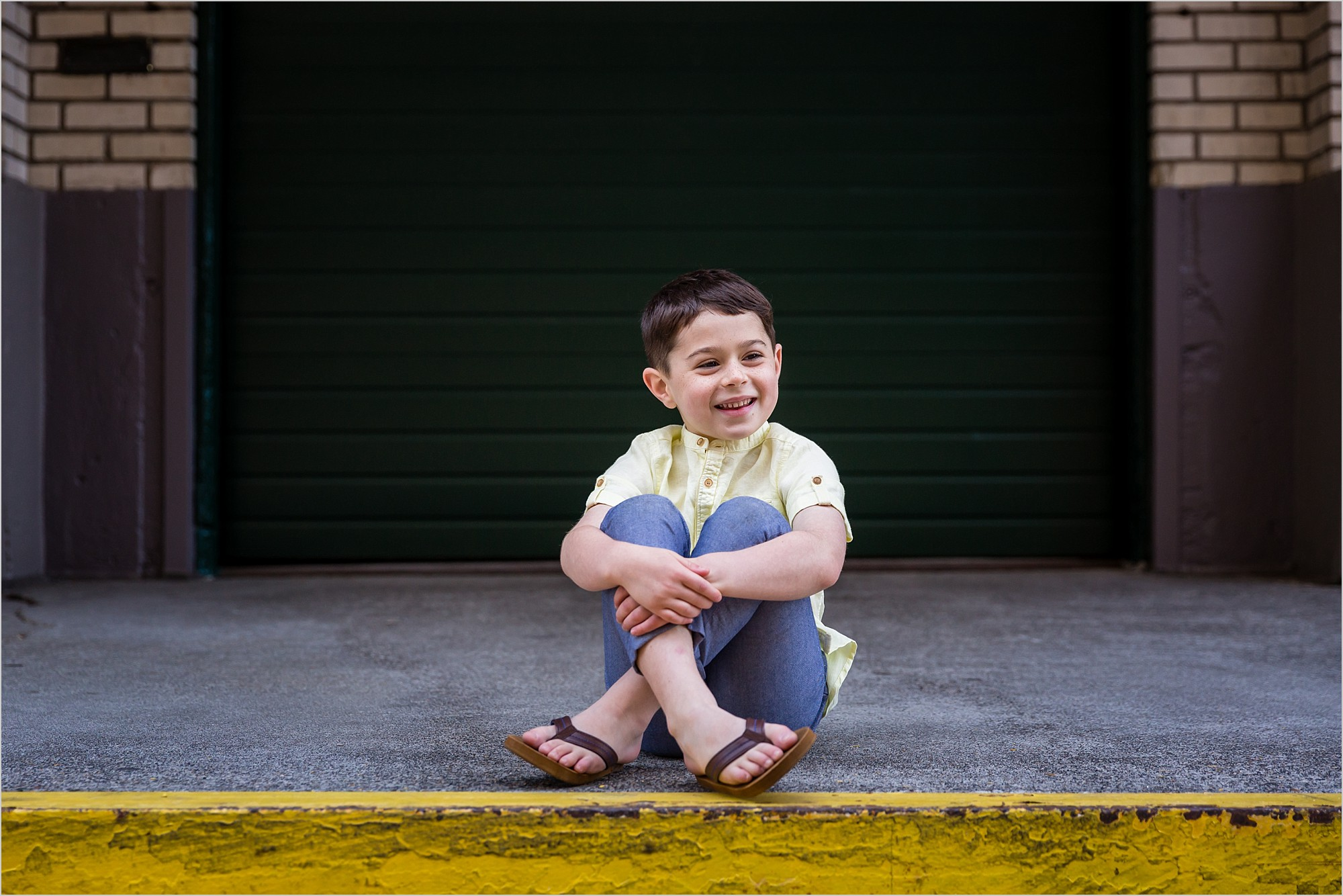 portrait of a child in downtown portland by hunnicutt photography