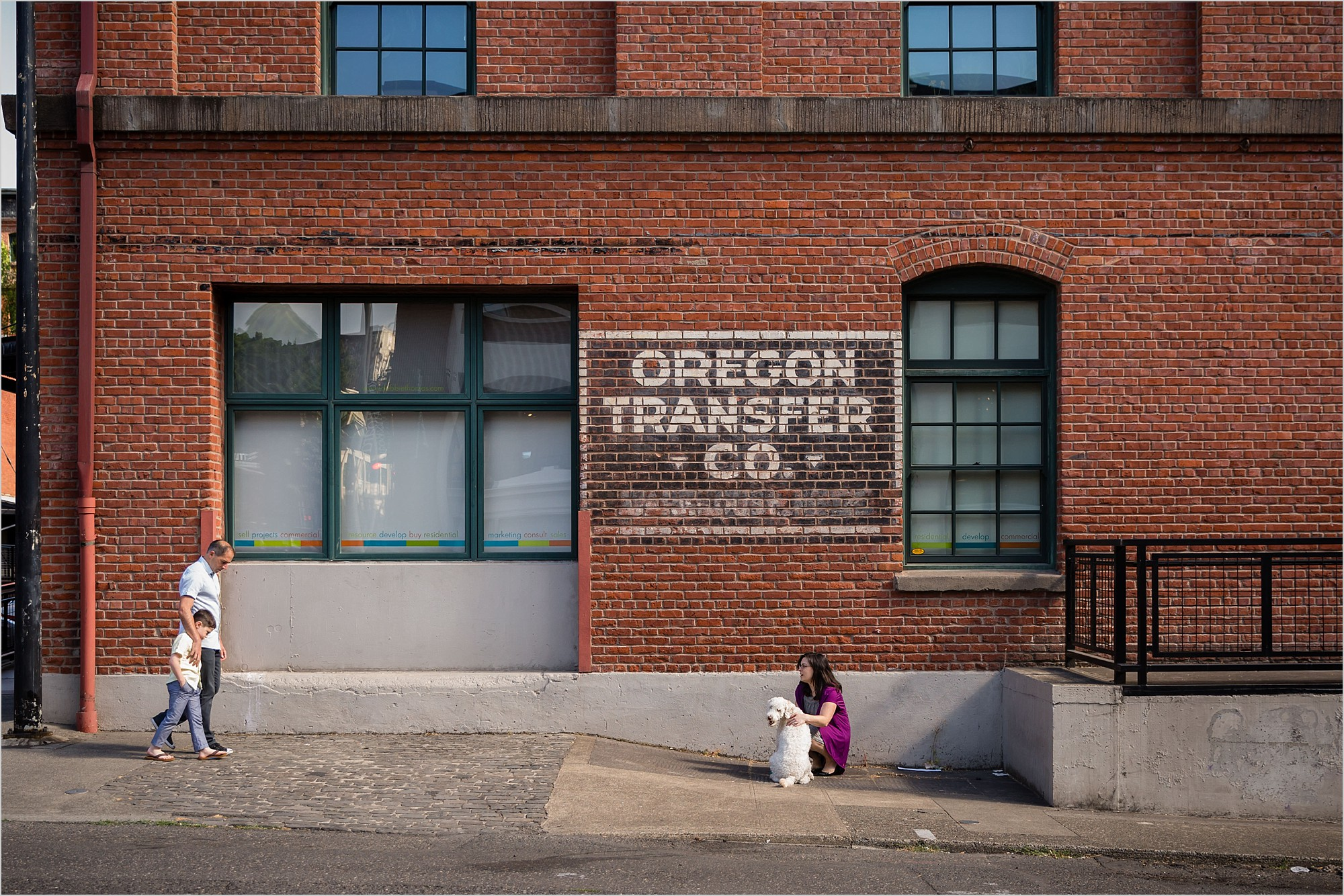 family walking by oregon transfer co sign in downtown portland oregon for lifestyle urban family photos by hunnicutt photography