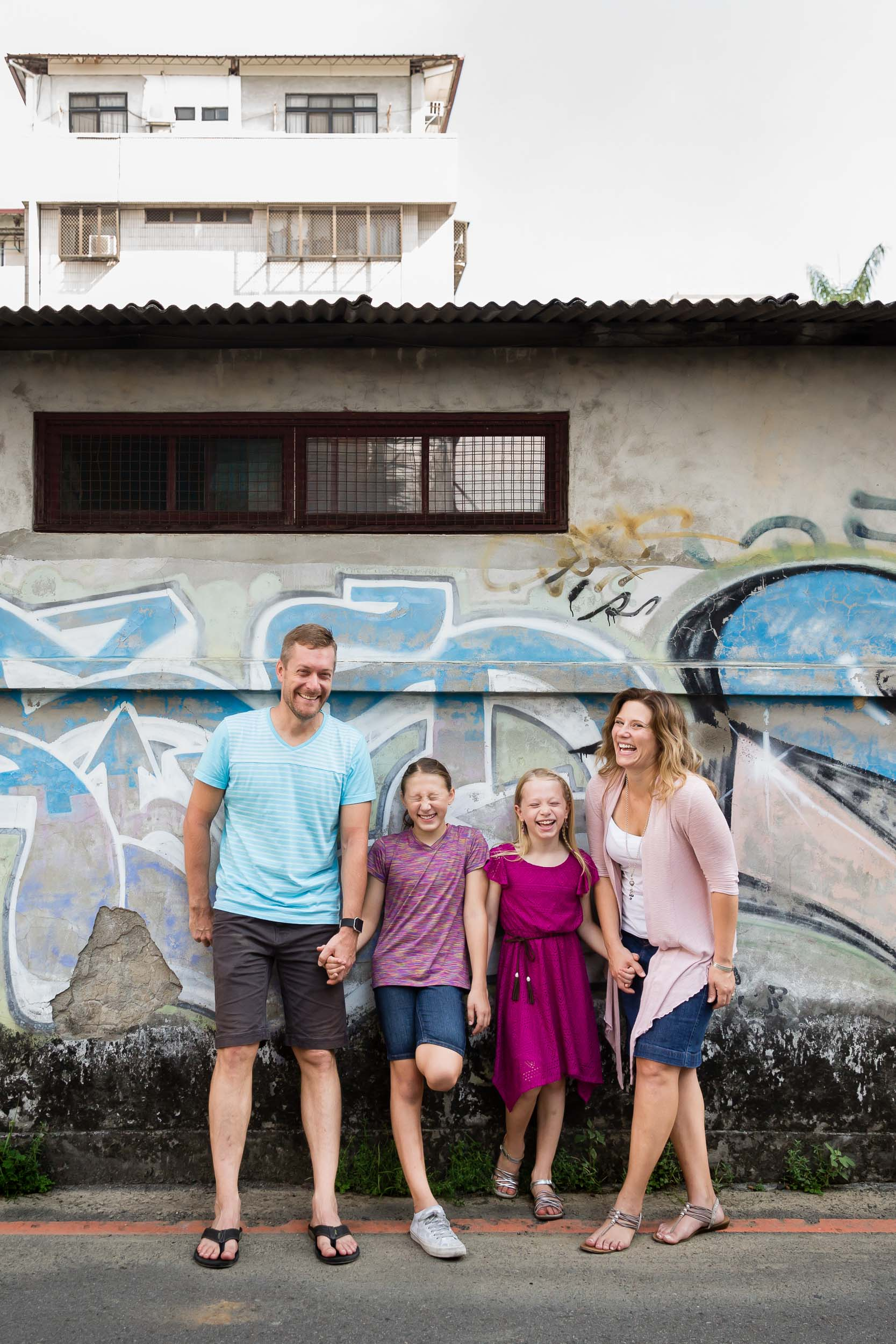 family of four with two school age daughters by graffiti wall Huninicutt Photography, portland oregon and vancouver washington lifestyle photographer