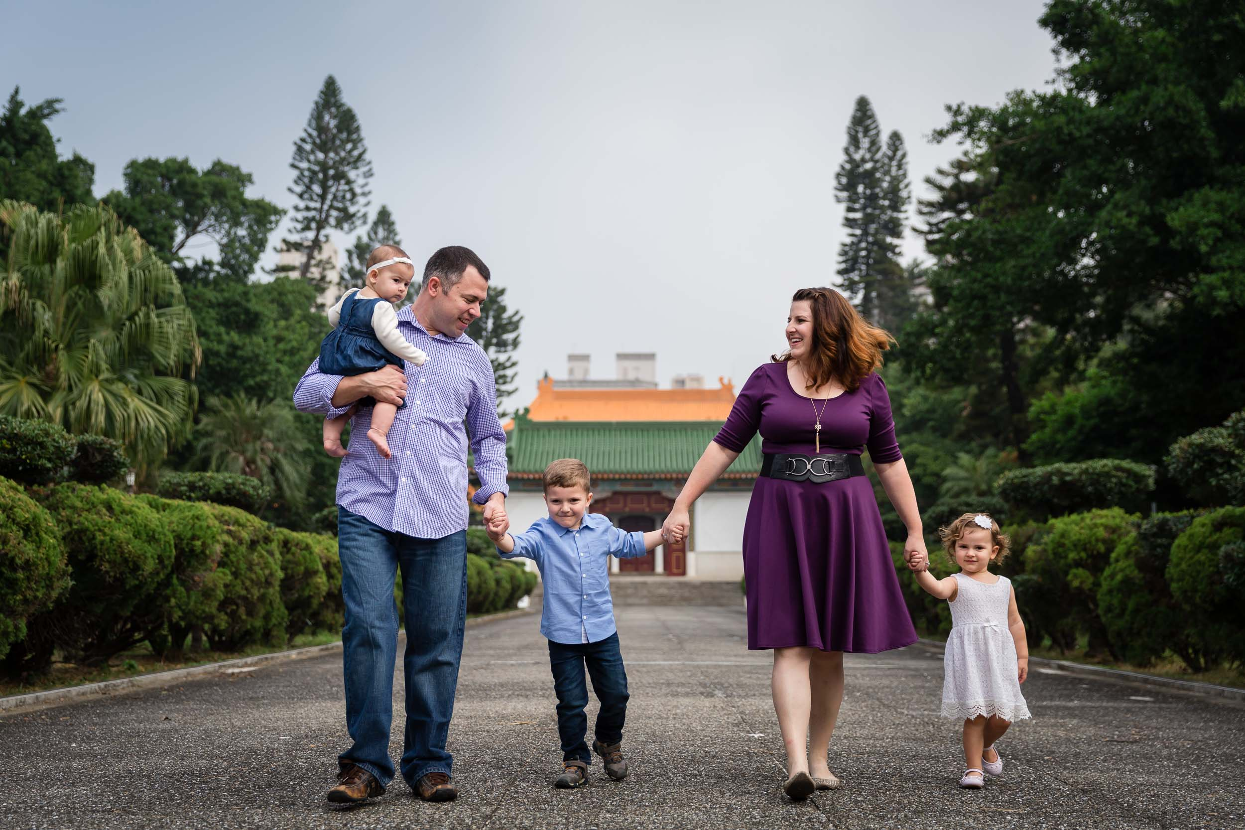 family of five with mom in purple dress and baby in jean jumper exploring by hunnicutt photography portland oregon and pacific northwest premiere child and family lifestyle photographer