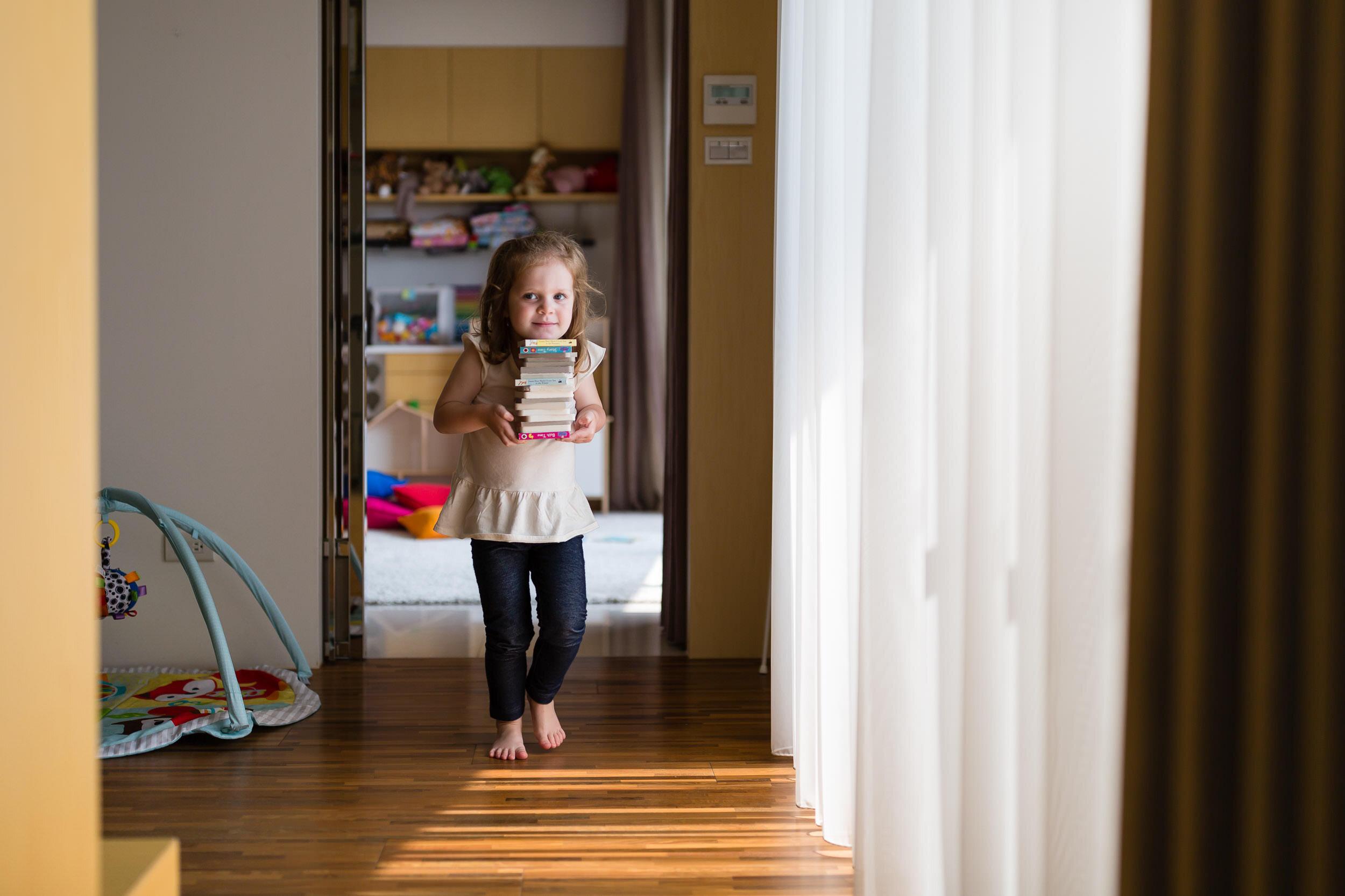 girl-with-books-In-Home-photography-storytelling-family-session-portland-oregon-rebecca-hunnicutt-farren-20.jpg