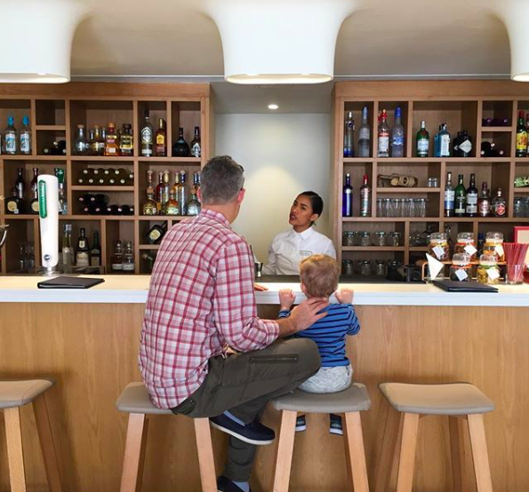 Father-son cocktails at Finest Playa Mujeres while Mom checks in. Image Credit:  Ruby Rosen Instagram feed