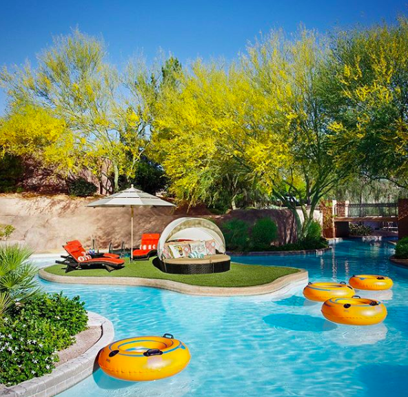The Westin Kierland's lazy river. Covered private cabanas are also available for rent.