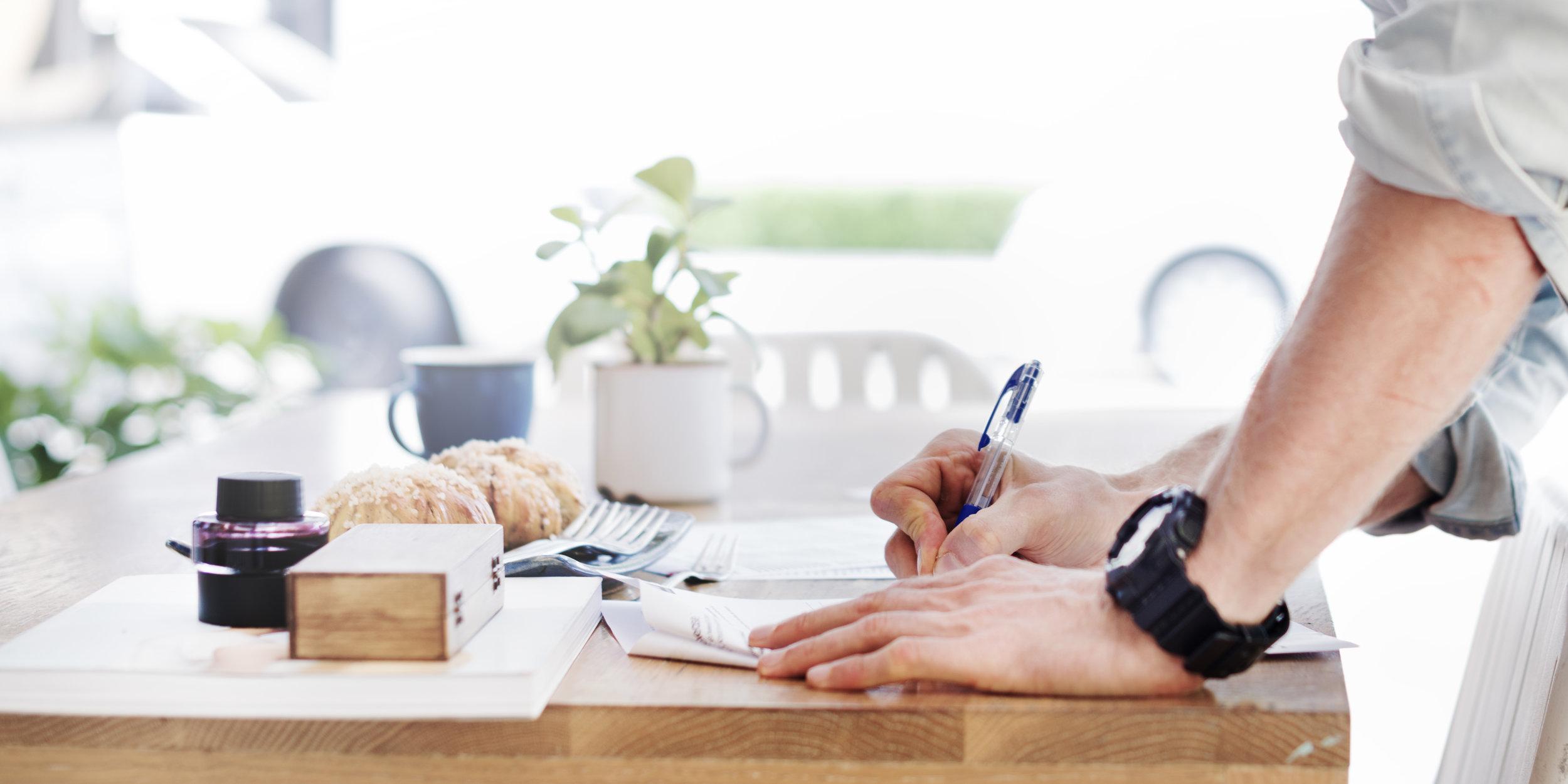 Man writing at desk