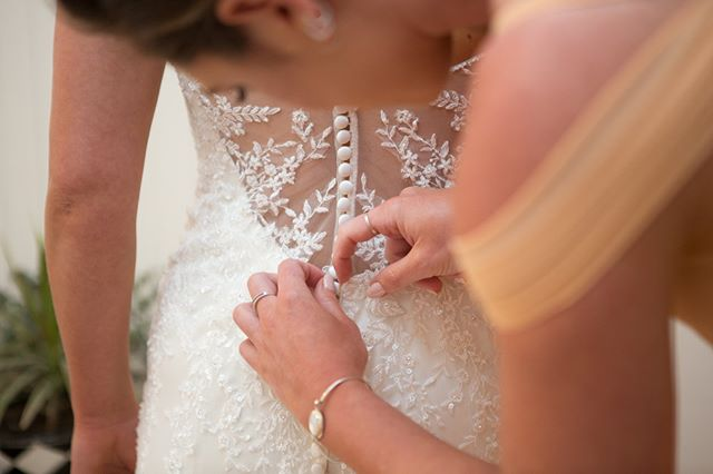 one button closer to becoming a MRS.  #bridalprep #suffolkbrides #ukweddingphotographer #bridesmaidduties #gettingherready