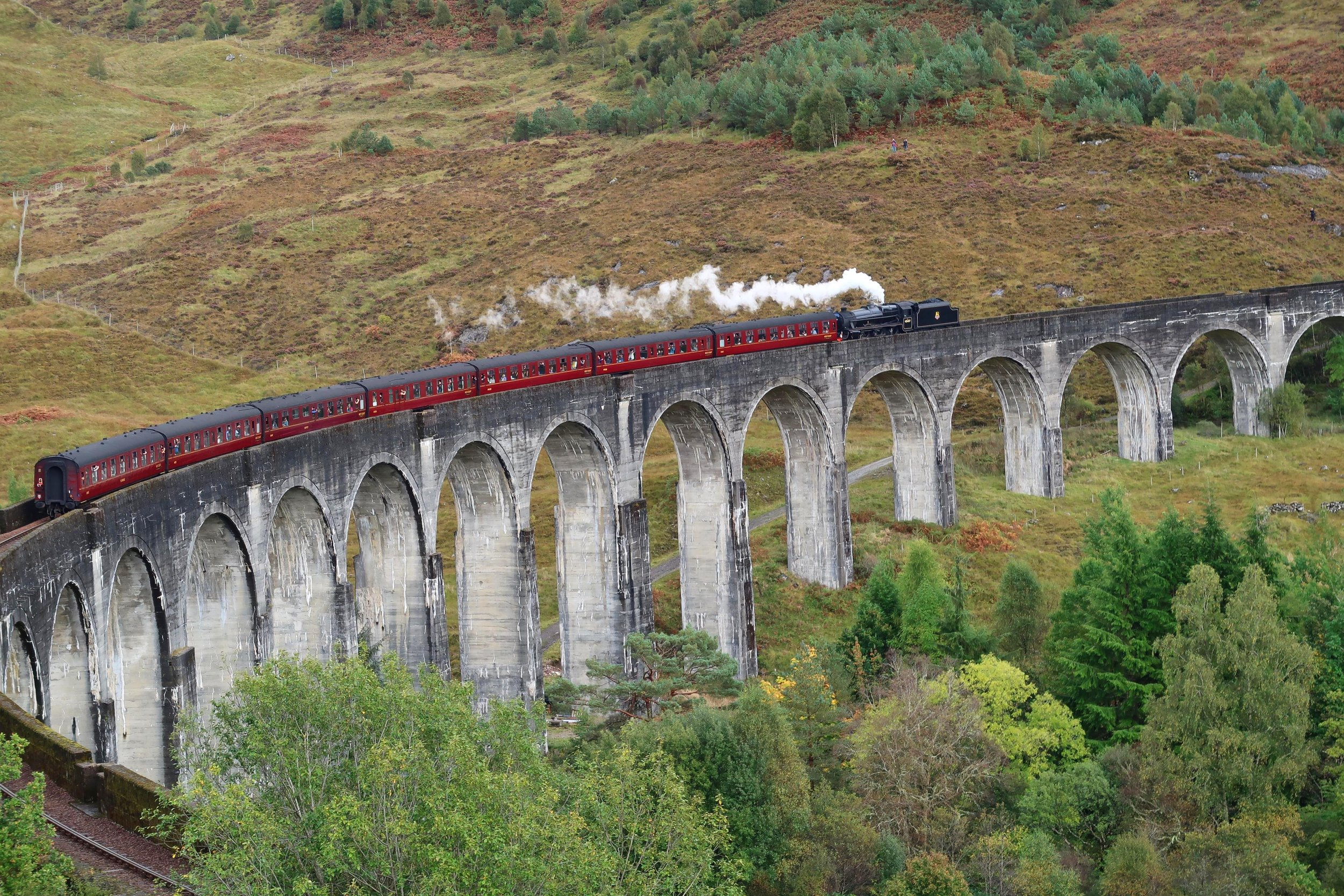Visit the Glenfinnan Viaduct - Every Harry Potter fan won't want to miss this sight. Watch the Hogwart's Express fly along the most iconic of Scottish railway lines.