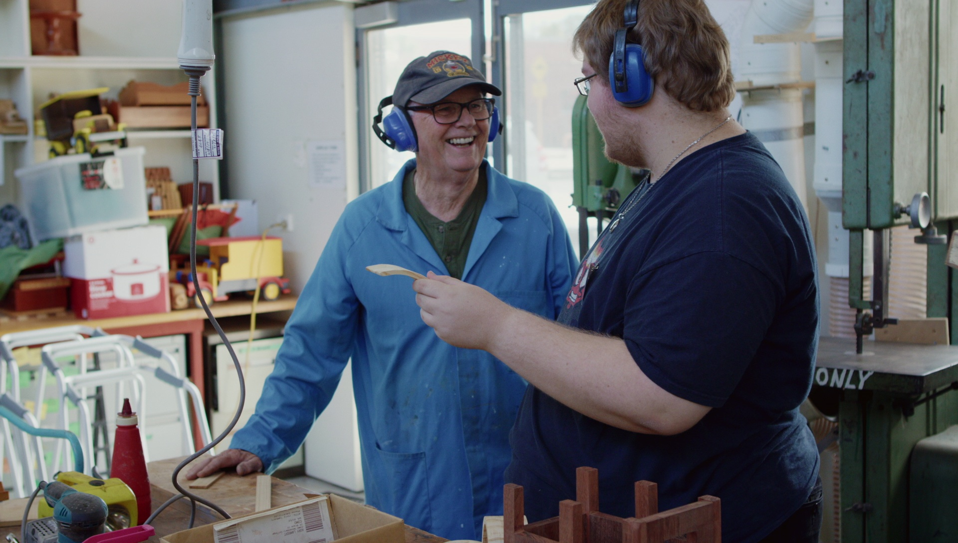 Image from Intergenerational film. Two men interacting with one another in a tool shed