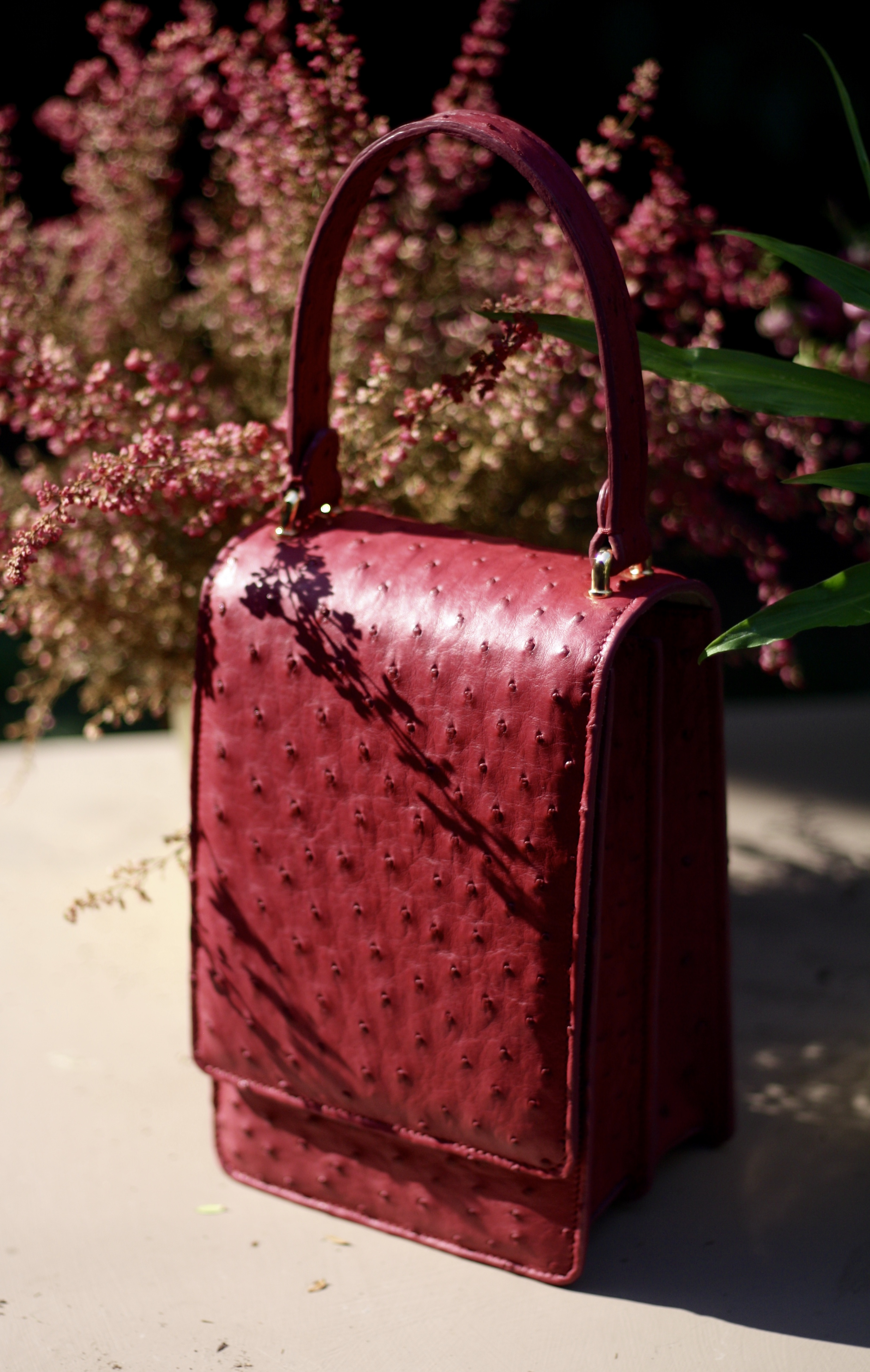 - Elizabeth Lombardi exotic skin handbags are meticulously hand crafted in Milan, Italy. From initial design through to finished product, each stage is executed in house by Elizabeth.