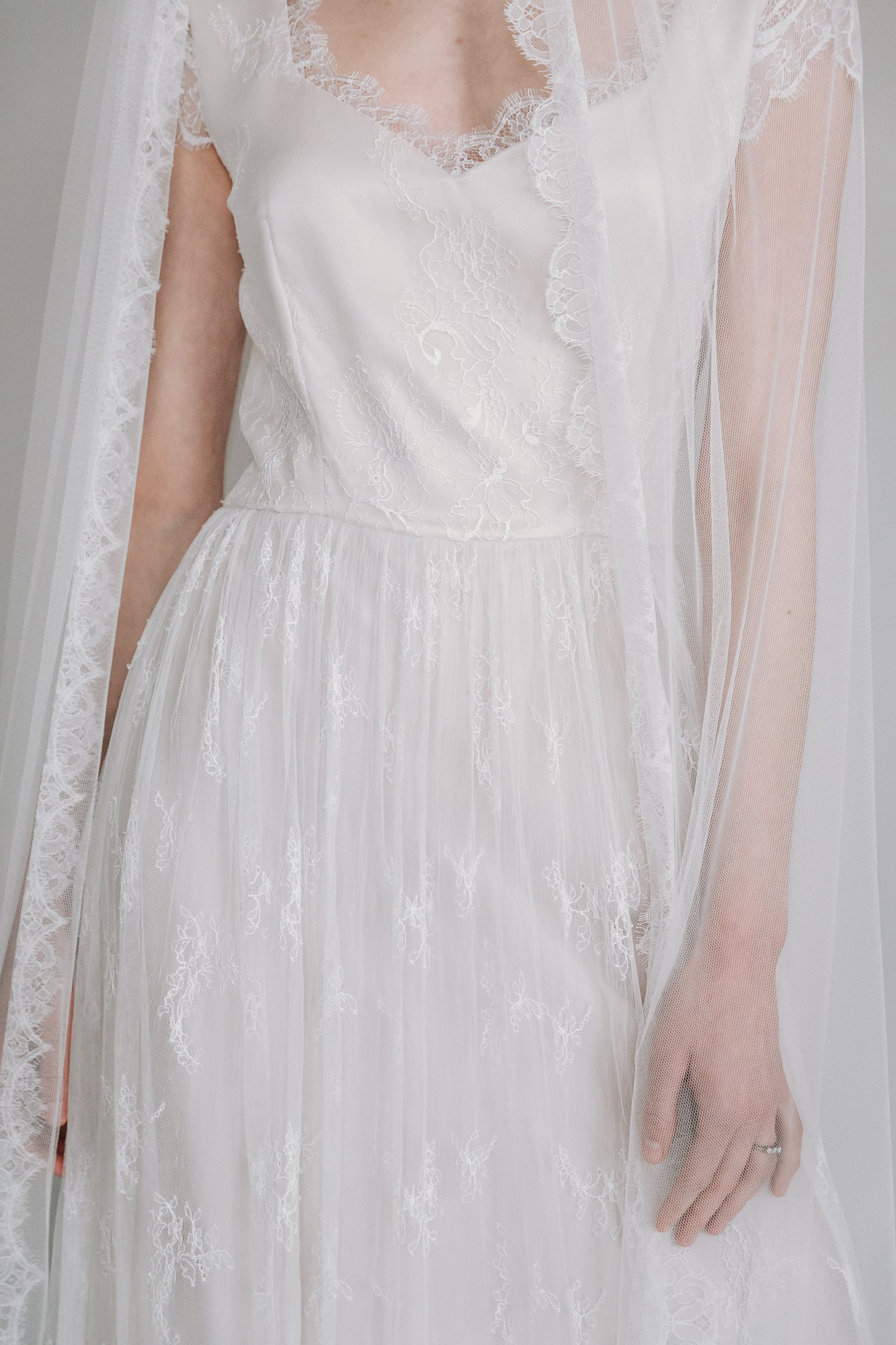 Kate-Beaumont-Sheffield-Hollyhock-Delicate-Ethereal-French-Lace-Blush-Silk-Wedding-Gown-1.jpg