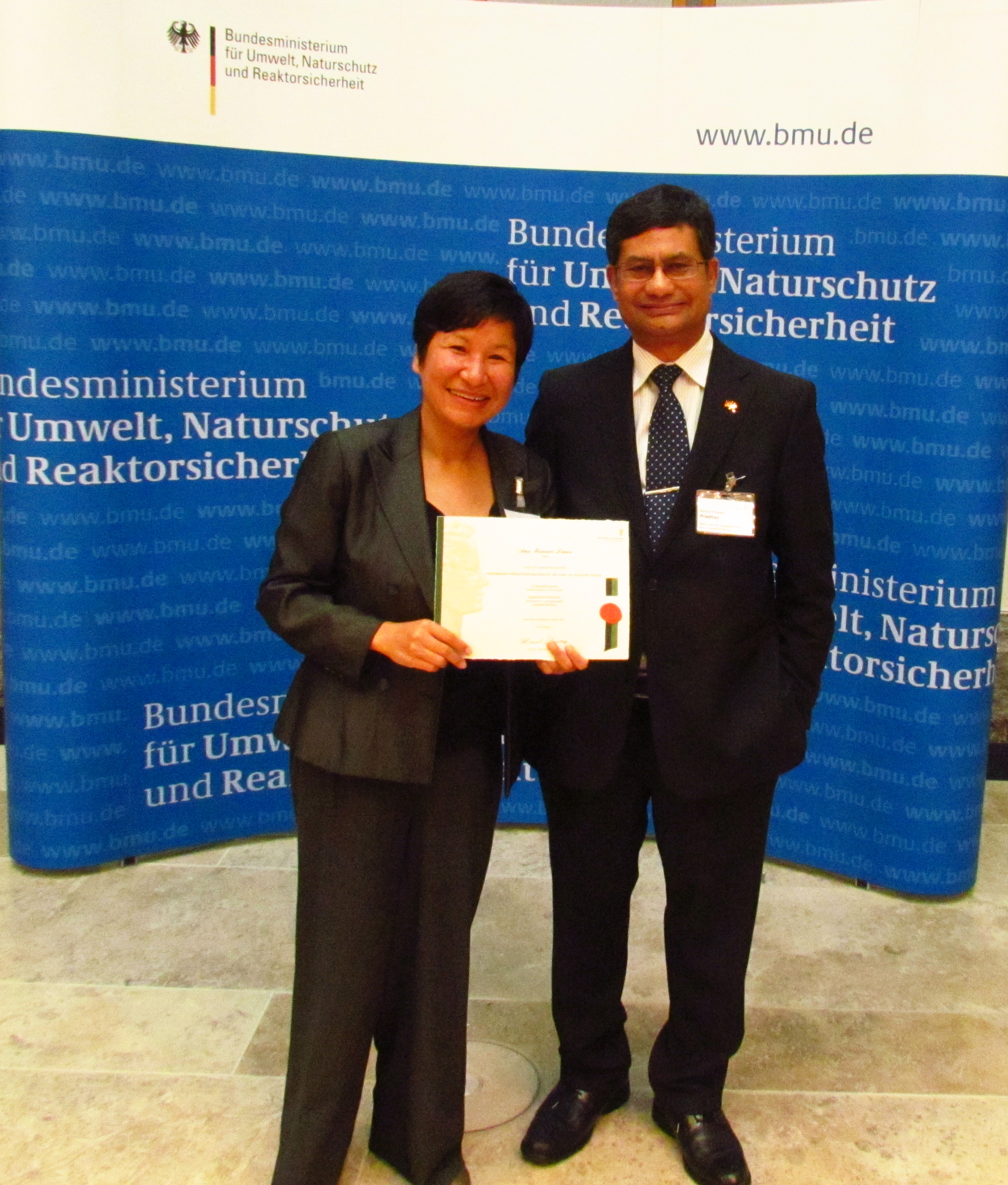 Anu, with Nepal ambassador at the German State Parliament, 2012.
