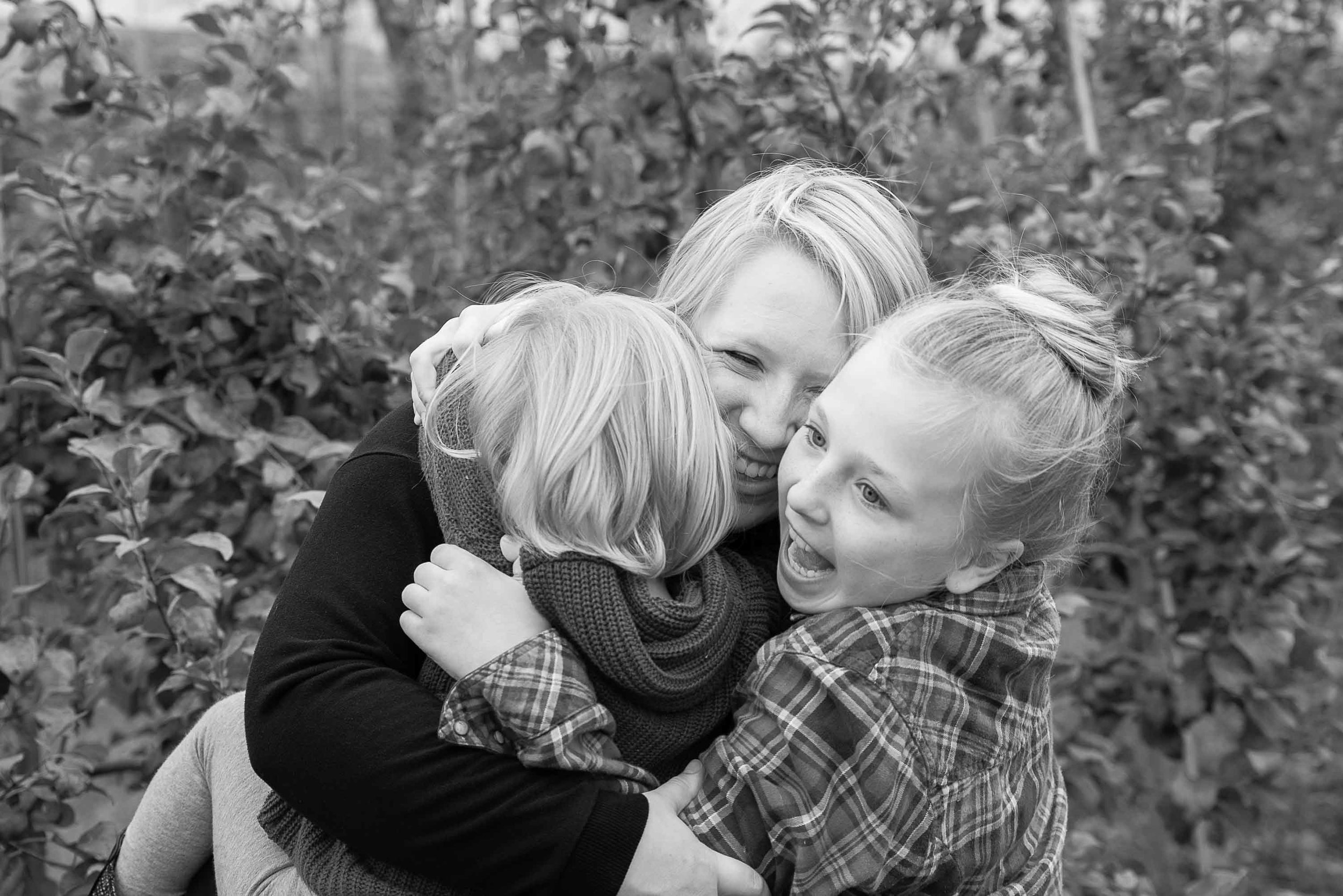 Family photographer mom hugging daughters | Life and Art Photography | Minneapolis Saint Paul and Denver Family Photographer.jpg