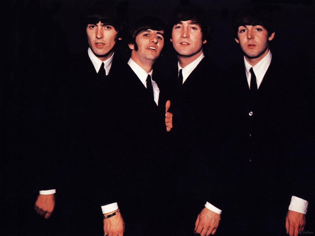 the beatles in black suits.jpg