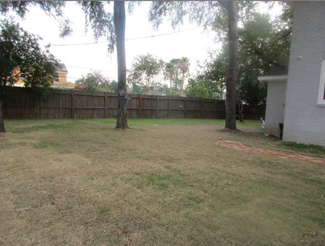 Demo of garage & new grass: after