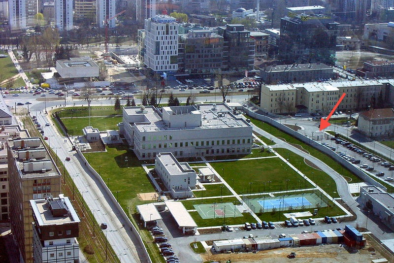 Former area of Marsala Tito Barracks nowadays with the US Embassy of Bosnia Herzegovina and its security wall blocking the area from the city of Sarajevo. Arrow marks the camera position from 2008, Was bleibt I Sta Osaje I What remains  Photo: Brian Eager, via Wikipedia Commons