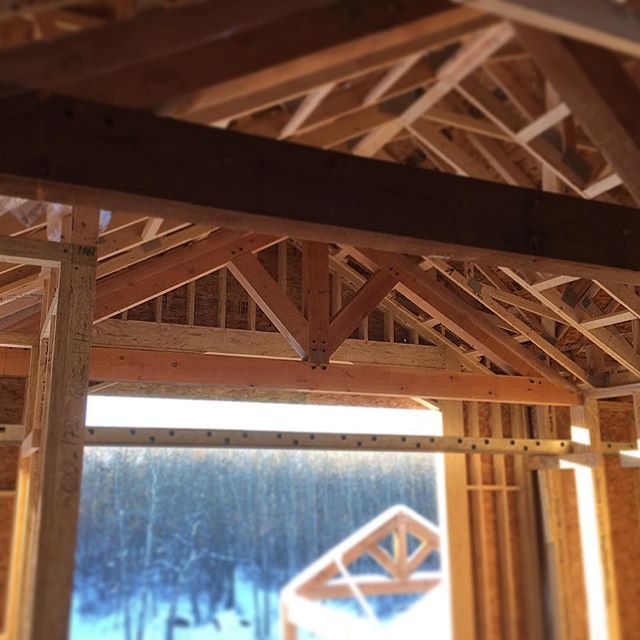 Fun day working with my old mentor I used to work under when I was nineteen. Getting creative trying to set these 600lb timber trusses in a interior vault after the roof is on. Thanks @bengelcustomhomes for giving me the ability to work with your father again!