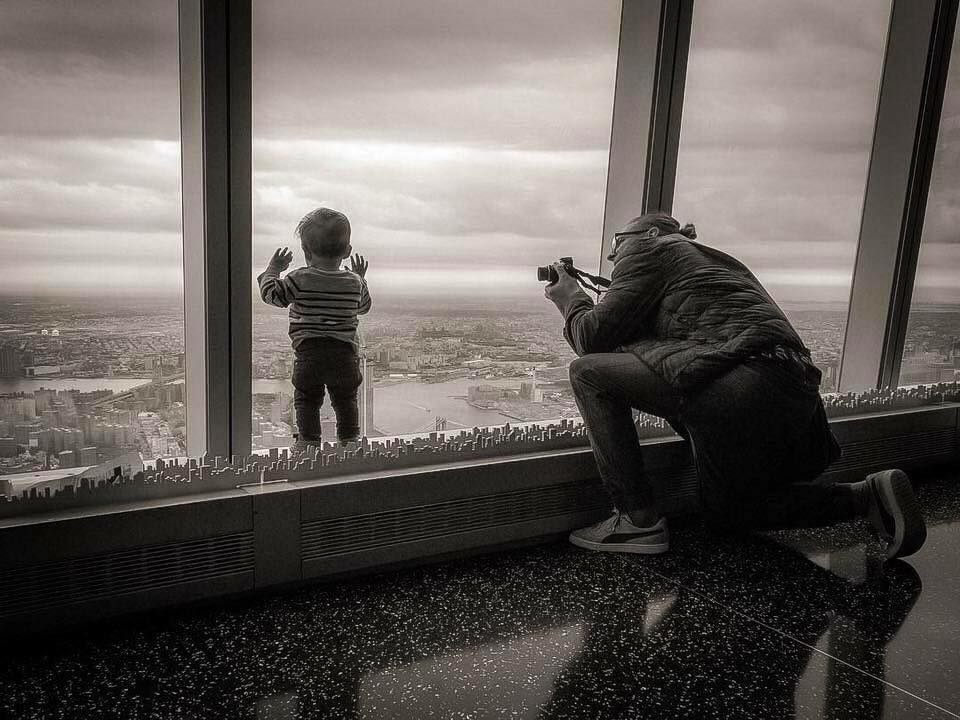 UN PICCOLO MESMERIZED WITH THE AMAZING VIEWS FROM THE 102ND FLOOR OF THE ONE WORLD TRADE CENTER. PHOTO:  ONE WORLD OBSERVATORY