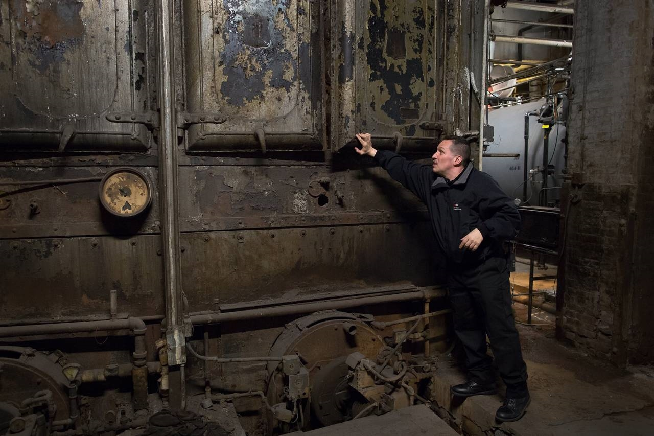 Superintendent Sunny Atis in the boiler room of the Flatiron Building. (PHOTO: Agaton Strom for The Wall Street Journal)