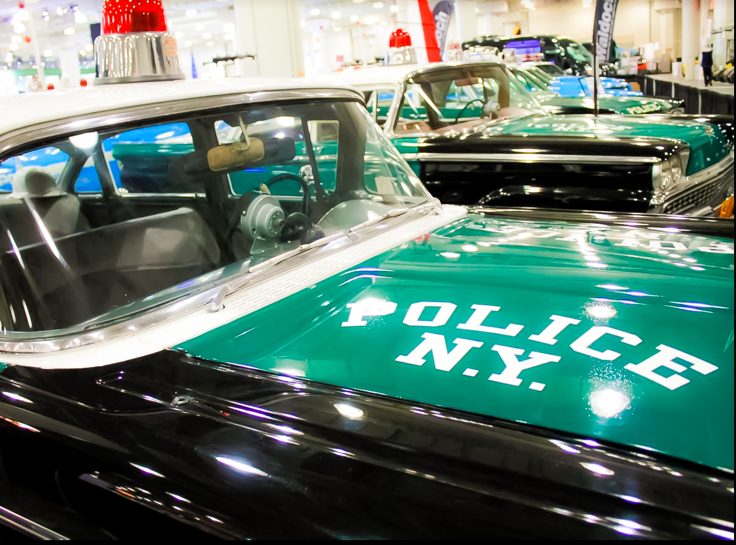 """1966 CHEVROLET BISCAYNE – The green and black color scheme was common for early NYPD cars. Green was the department's signature color, a reference to the green lights that members of """"the watch,"""" the first police agency in the united five boroughs, used to keep outside their homes to show they were on guard."""