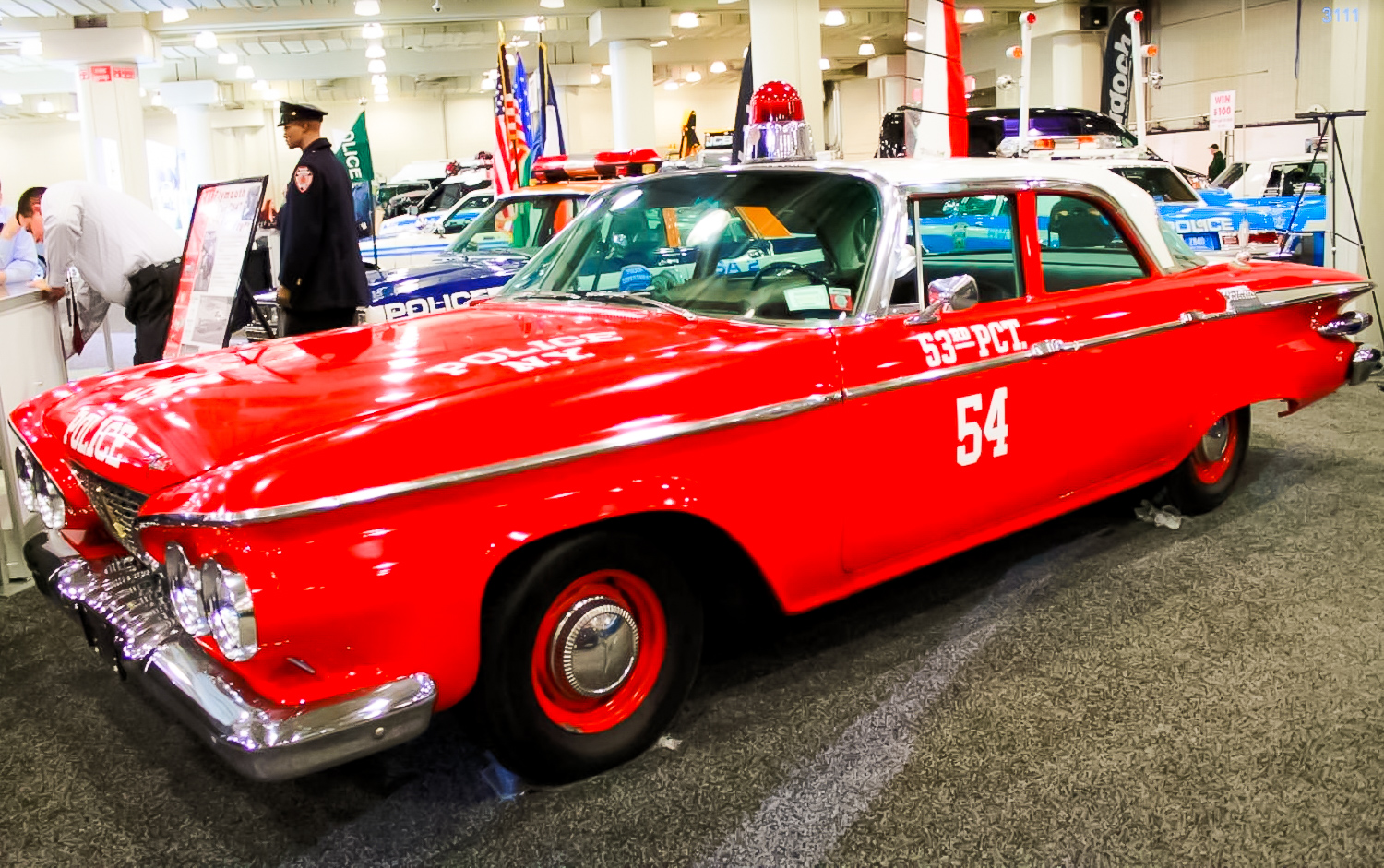 """1961 PLYMOUTH SAVOY – If you're thinking there might be something fishy about a cop car with a red paint job, you're absolutely right. This '61 Plymouth was a prop for the 1960s show """"Car 54, Where Are You?"""""""