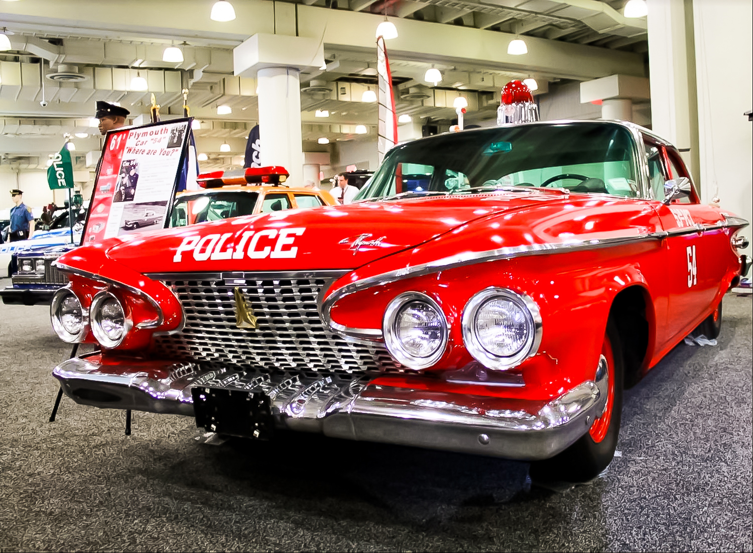 1961 PLYMOUTH SAVOY – The car was given a bright red paint job specifically to avoid any confusion with a real NYPD patrol car.