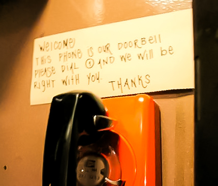in the phone booth, dial 1 and the hostess will answer your call to check your reservation