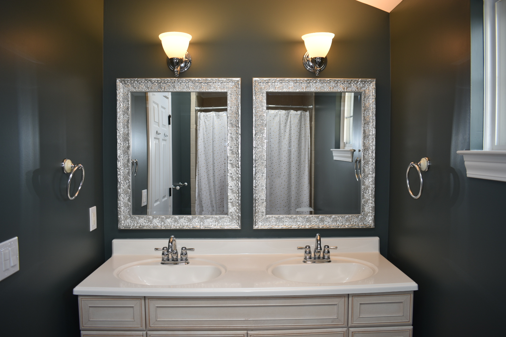 Absolutely loving the feel of our bathroom with a fresh coat of paint & the new mirrors.
