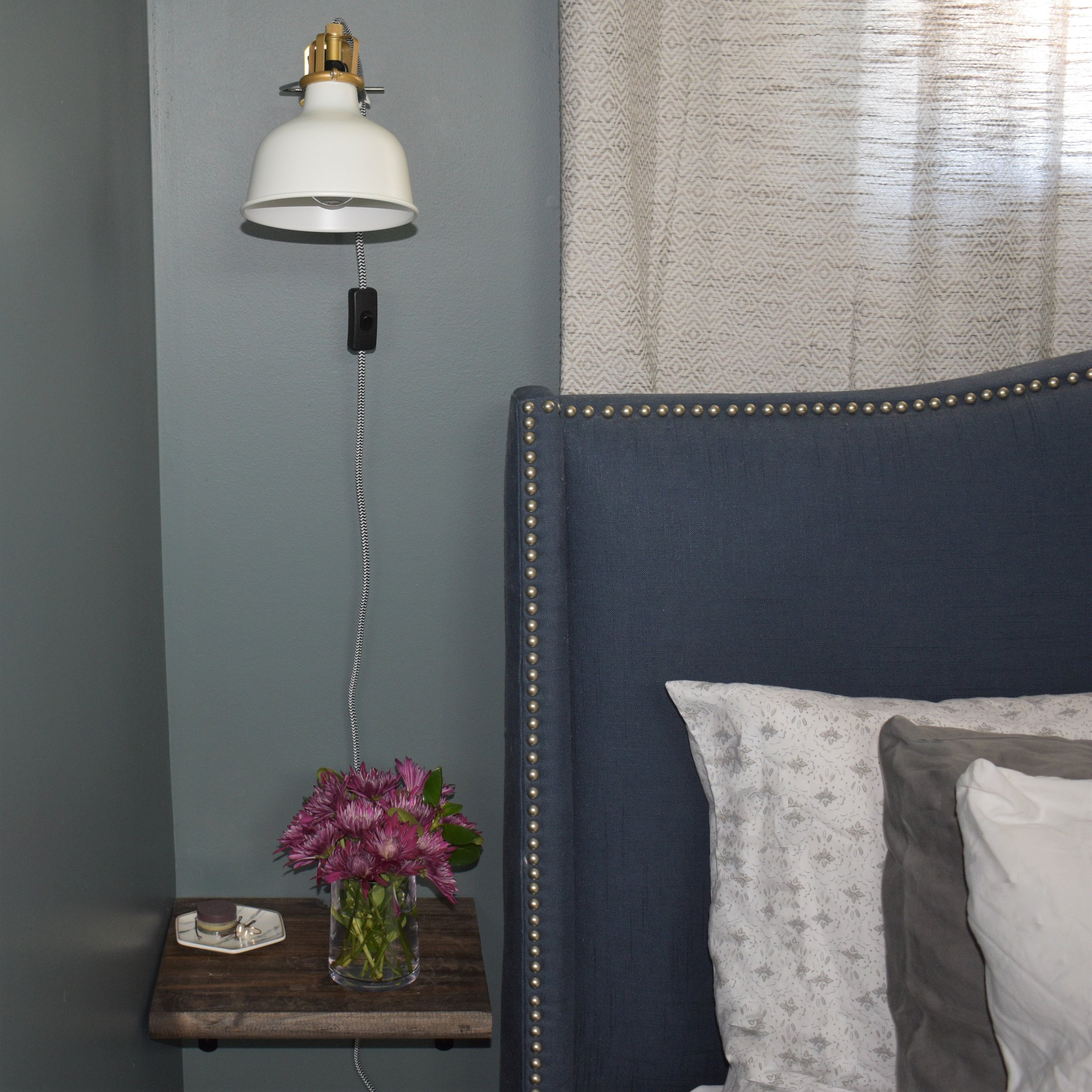 Our king bed barely fits in the space so my husband DIY-ed these floating nightstands!