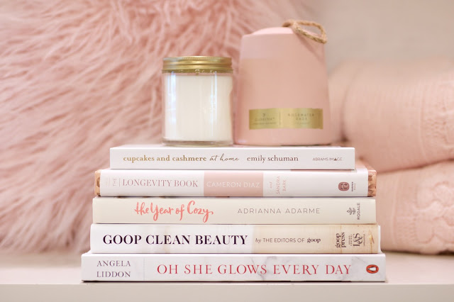 (image credits:    erica cook   )     vela    /    cupcakes and cashmere at home    /    the longevity book    /    the year of cozy    /    goop clean beauty    /    oh she glows every day