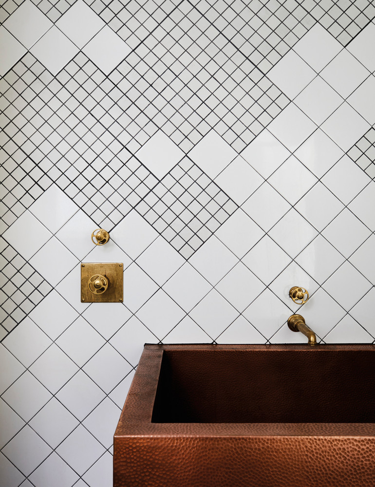opposites-attract-in-this-artfully-balanced-san-francisco-home-bronze-and-brown-and-white-bathroom-59db8d98d9b1651460d81c38-w1000_h1000.jpg