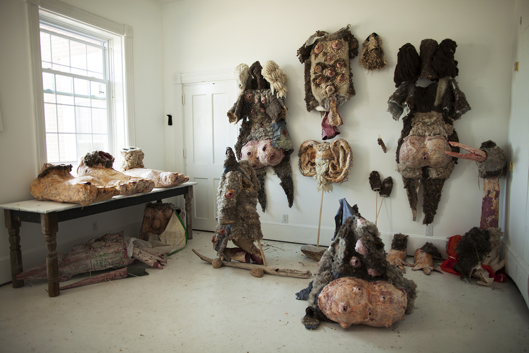 Taxidermy for humans of a dystopian future , 2016, papier-mâche, raw wool, felt, wax, latex, shellac, burlap, wood. Installed at The Lighthouse Works, Fishers Island, NY