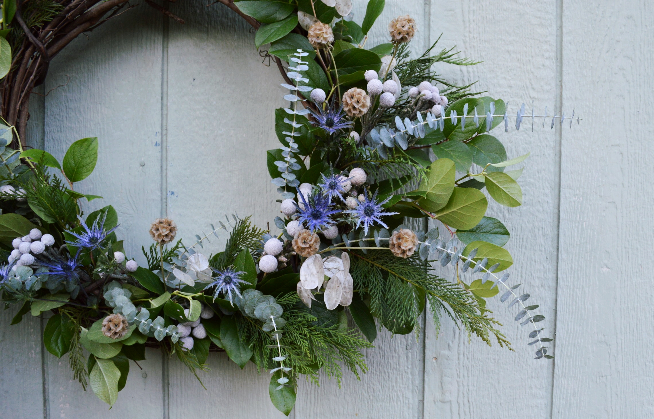 wreaths - We start with a grapevine wreath, add long lasting greenery, and then embellish from there. Wreaths for homes use dried floral and greenery elements, while wreaths for events can use fresh flowers.