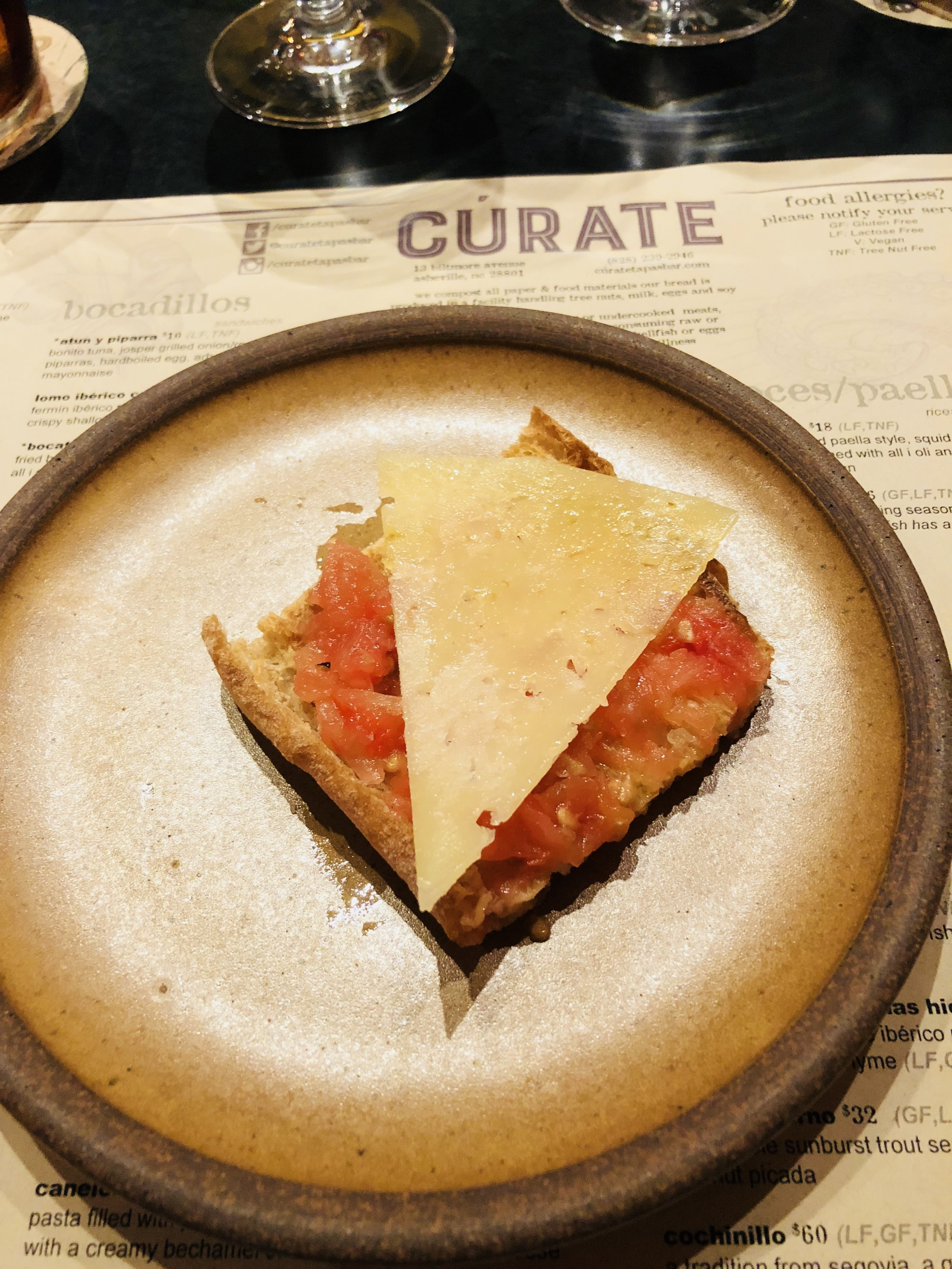 Pain de cristal con tomate with manchego cheese at Cúrate in Asheville
