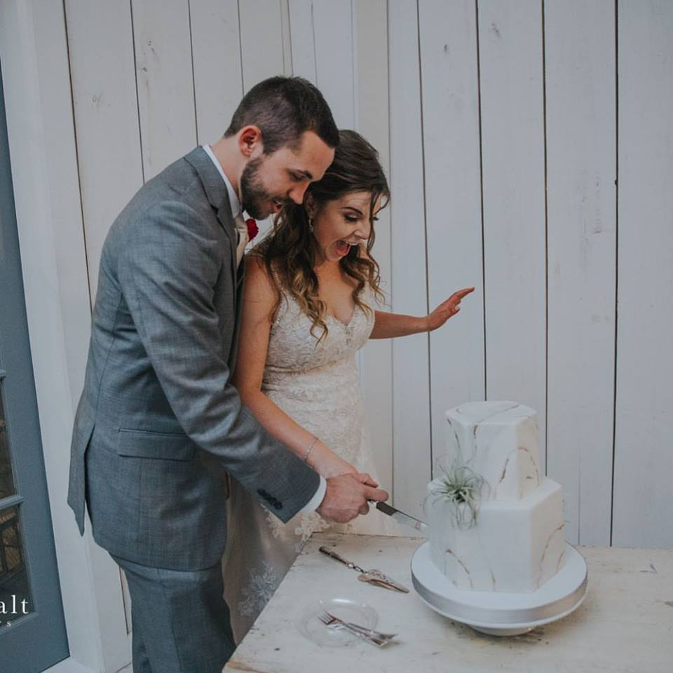 bride groom with cake.jpg