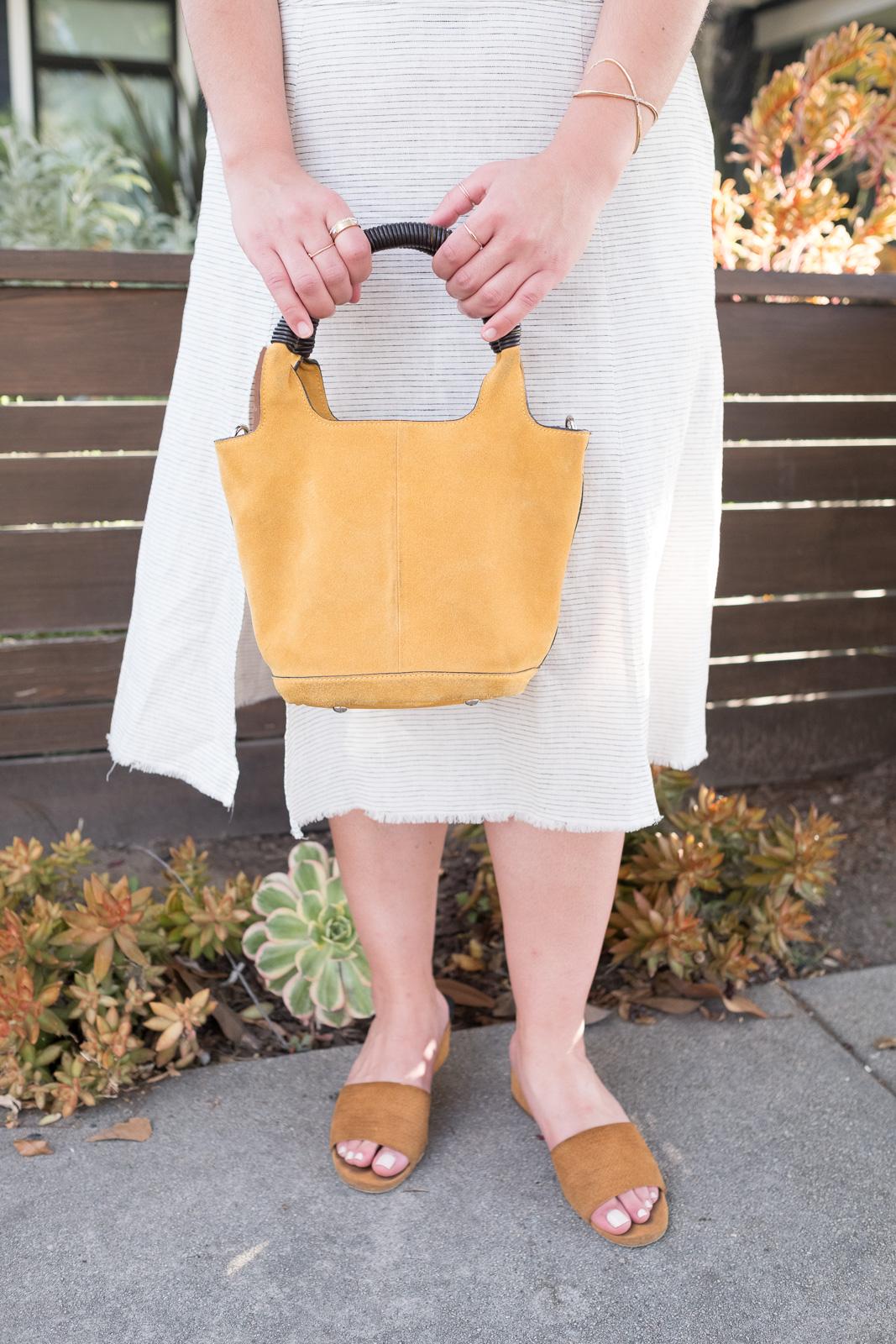 Striped linen skirt Yellow suede bucket bag via spiga slides.jpg