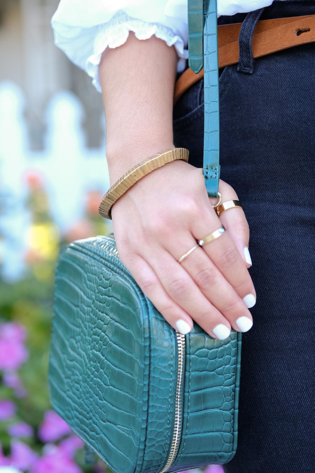 Green bag layered jewelry