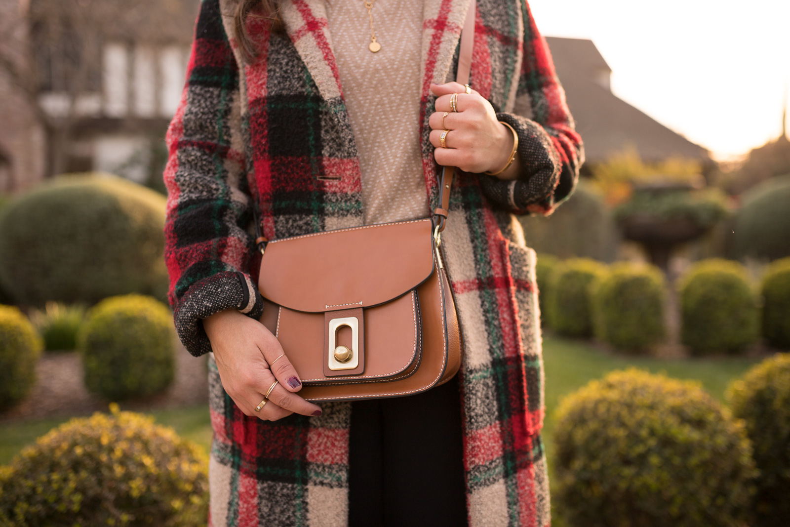 layered rings and a zara plaid coat
