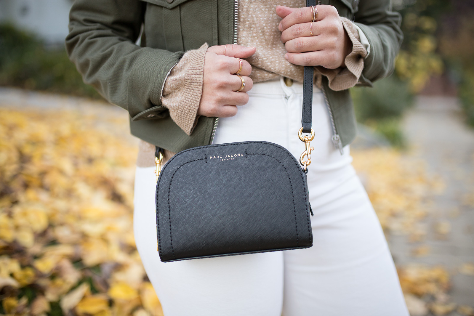 layered gold dainty rings and a marc jacobs crossbody