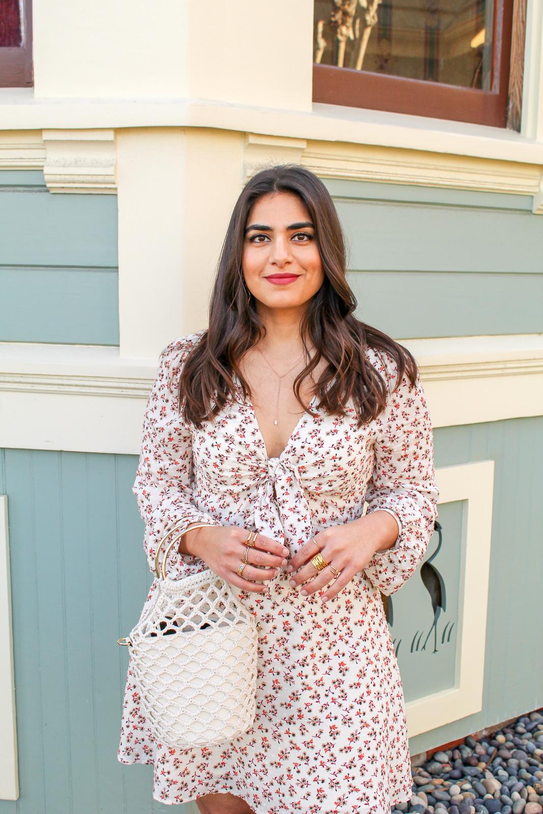 Noyemi Kelemdjian in a long sleeved floral dress
