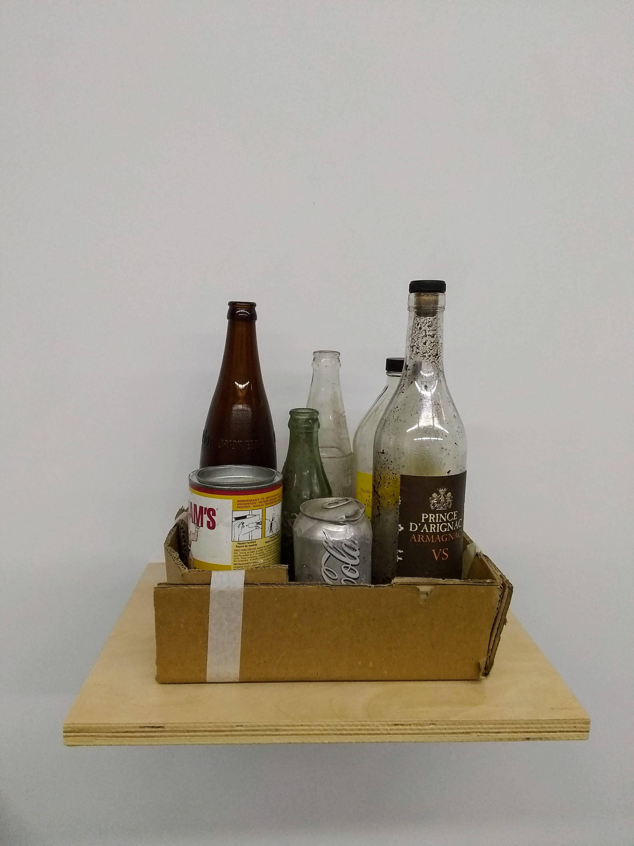 """Bottles and Cans, 2019, bottles, cans, cardboard and tape 11 x 8 x 13"""""""