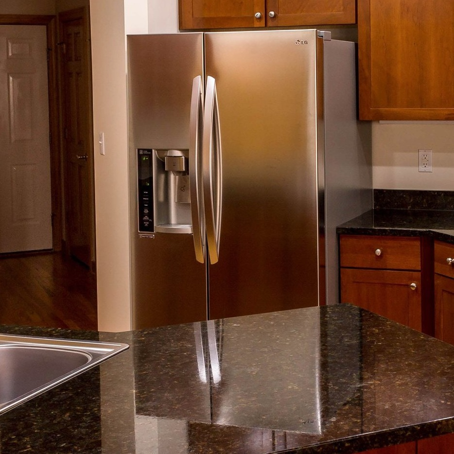 That refrigerator sure is pretty there, but make certain you'll be able to fully open both doors.