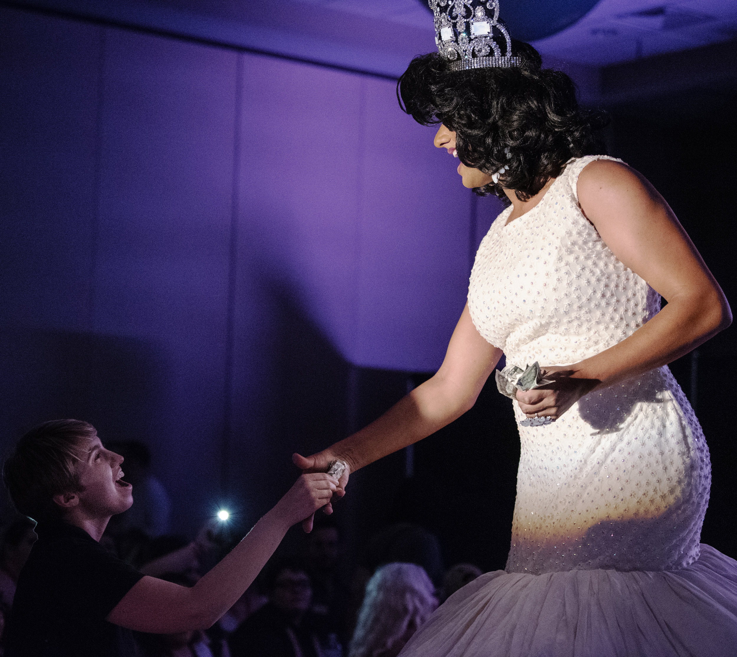 Knight grabs the hand of an audience member during the WKU Drag Show.